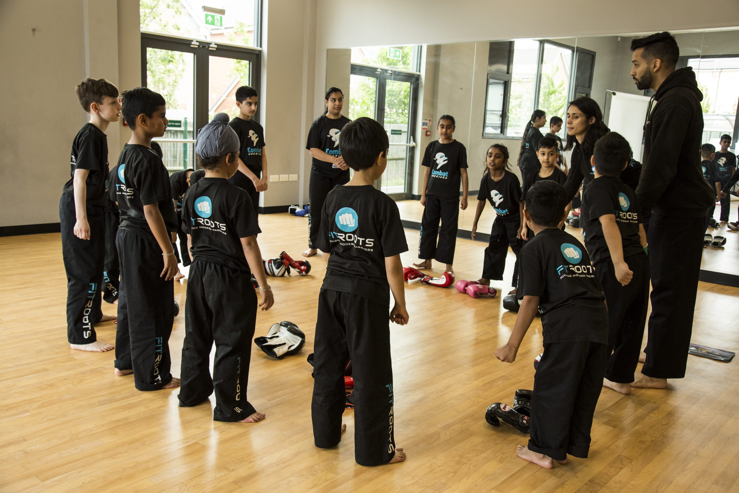 Combat Warriors Bowing in Martial Arts Class